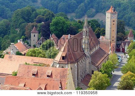 ROTHENBURG OB DER TAUBER GERMANY - AUGUST 10, 2015: Aerial view of Rothenburg ob der Tauber and the Franciscan church (the oldest in the city) from the Town Hall Tower in Bavaria Germany. It is part of the famous Romantic Road tourist route.
