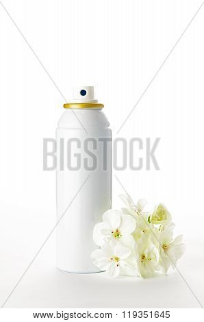 Metallic Spray Bottle And Flowers On The White Background