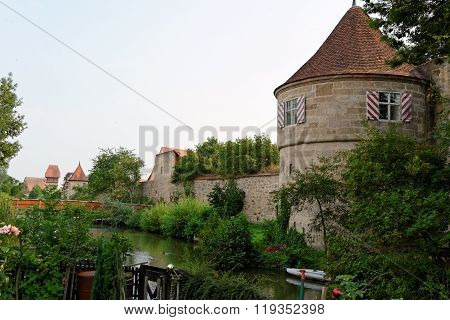 Town's walls of Dinkelsbuhl Bavaria Germany. Dinkelsbuhl is old Franconian town one of the best-preserved medieval urban complexes in Germany.
