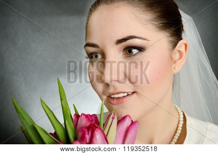 Bride With White Veil And Flowers