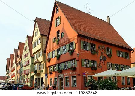 DINKELSBUHL GERMANY - AUGUST 10 2015: Wine market street with its magnificent gabled buildings. Dinkelsbuhl is old Franconian town one of the best-preserved medieval urban complexes in Germany.