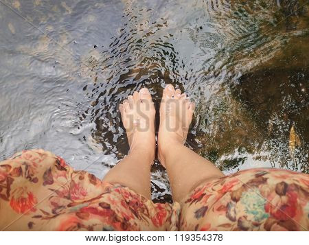 Top View Of Women Leg And Feet Dip In Crystalline Stream