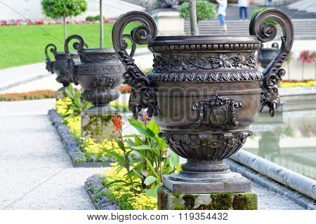 Row of cast zinc vases decorating the large basin in front of the Linderhof palace in the Bavarian Alps.