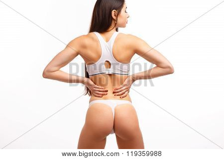 Young female touching her painful back