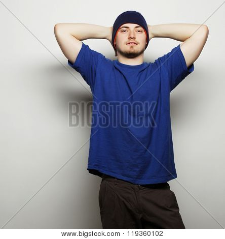 Life style, sport and people concept - young handsome man in blue t-shirt and blue hat.