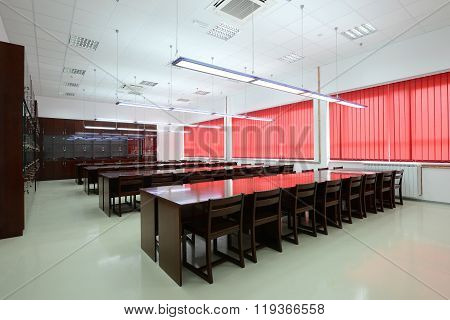 College classroom interior, empty classroom with desks and chairs