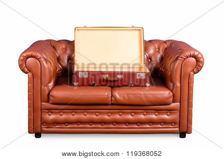 Old Leather Couch With An Open Vintage Suitcase