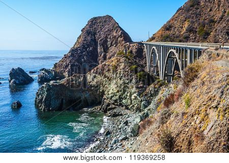 Great arch bridge - viaduct runs along the Pacific coast. California highway number 1. USA
