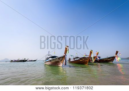 Anchored Wooden Long Tail Boats At Sea