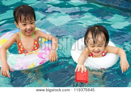 Asian Little Chinese Girls Playing In Swimming Pool