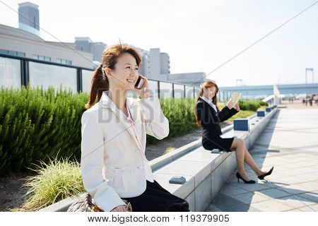 Beautiful asian woman working in the business district