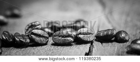 Coffee Beans Texture On Black And White On The Wood Background, selective Focus
