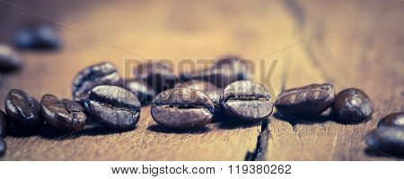 Coffee Beans Texture On The Wood Background, selective Focus, vintage Toning