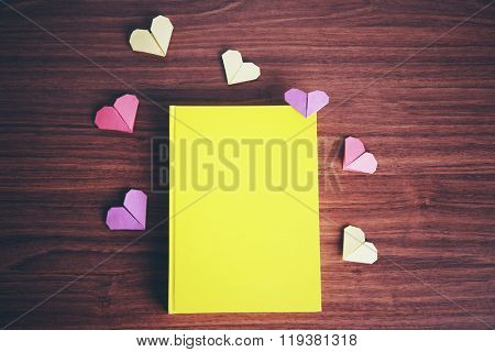 Heart bookmarks for book on wooden background