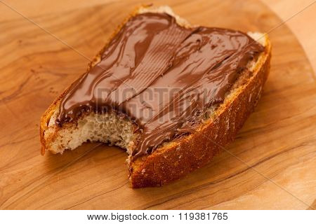 Slice Of Bread With Sweet Chocolate Nougat Spread, Bite.