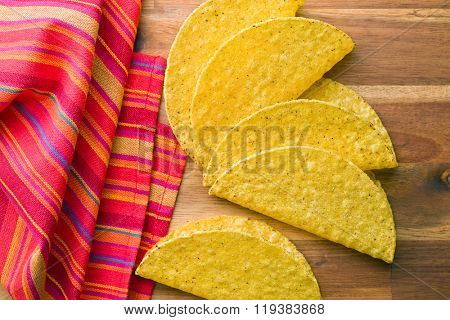 crispy taco shells on kitchen table