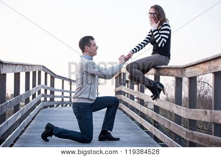 Man In Love Making Propose To A Surprised Girlfriend, Engagement.