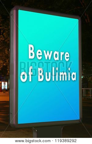 Advertise city-light with text Beware of Bulimia