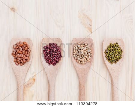 Assortment Of Beans And Lentils In Wooden Spoon On Wooden Background