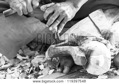Hand Of Carver Carving Wood In Black And White Color Tone