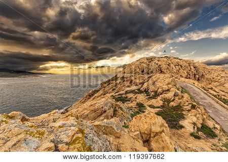 Moody Skies Over The Lighthouse At Ile Rousse In Corsica