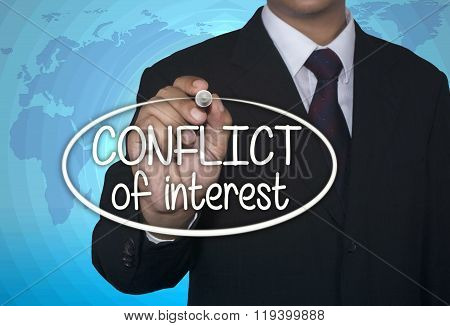 Business concept handwriting marker and write Conflict of Interest over light blue background with w