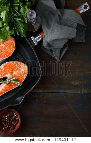 Raw Salmon Steak In Steel Griddle