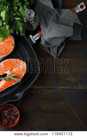 Raw Salmon Steak In Steel Griddle