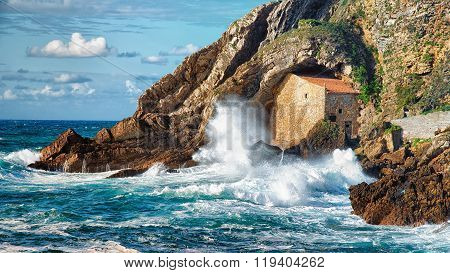 The waves hit an old hermitage