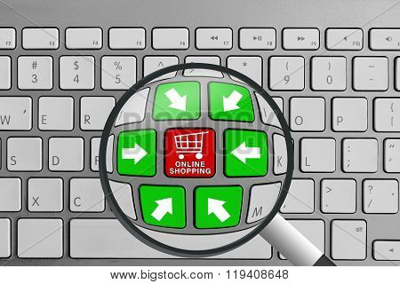 Keyboard with red and green online shopping theme buttons and magnifying glass