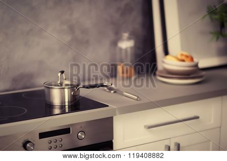 Modern electric stove with utensils in the kitchen