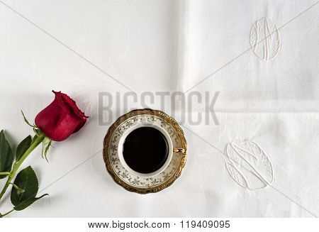 cup of coffee with red rose