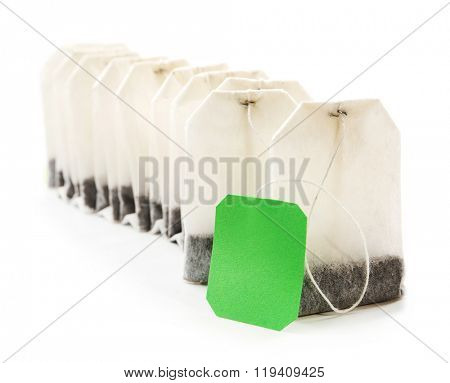 Unused teabags in a row isolated on white background