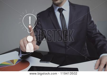 businessman presses the sign idea. business and technology concept