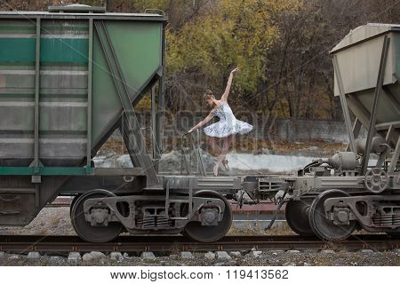 Ballerina between freight wagons