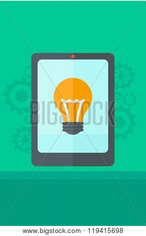 Background of digital tablet with lightbulb.
