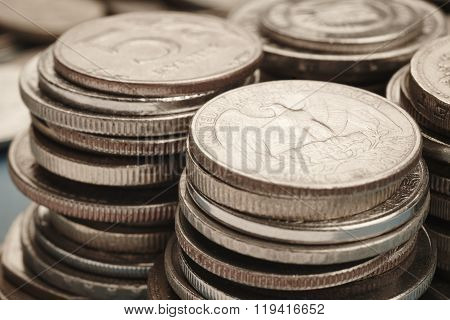 Different Kinds Of Coins Stacked. Quarter Macro Detail