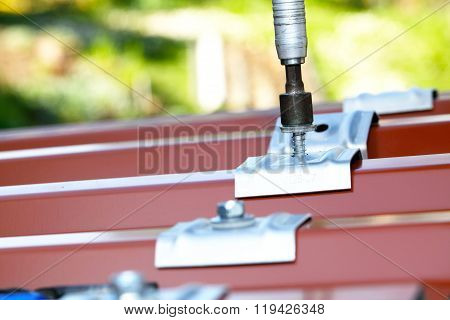 sheet metal roof with screws and mounted trapezoidal plate