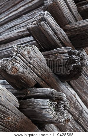 Corner Of Old Dark Wooden House Made Of Logs