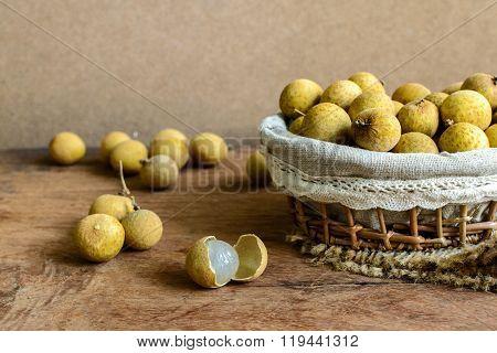 Longan (dimocarpus Longan) And Peel On Wooden Table