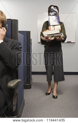 Woman carrying office equipment