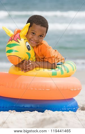 Boy hugging inflatable ring