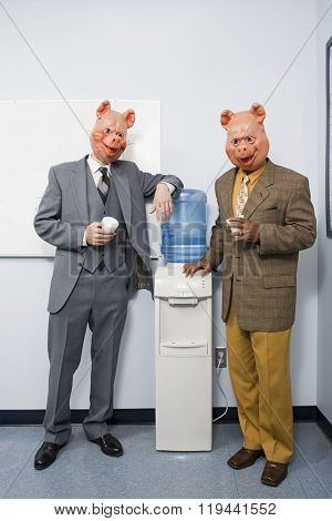 Two businessmen in pig masks