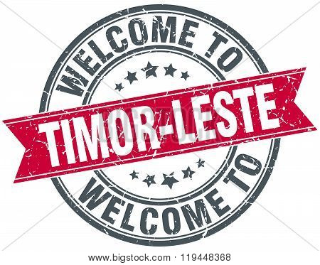 welcome to Timor-Leste red round vintage stamp