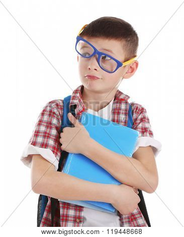 Funny little boy with plastic glasses and back pack holding books, isolated on white
