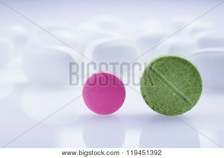 Pink and green medicine pills