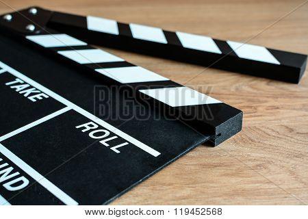Movie Clapper Board On Wooden Background