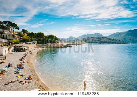 People resting at beach in Cassis, France.