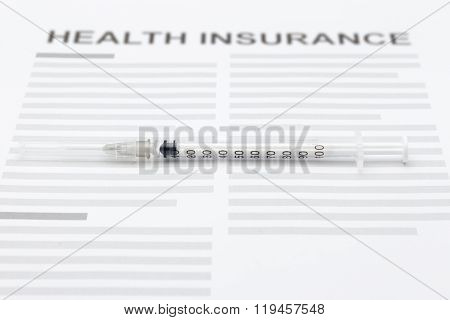 Health Insurance Form With Hypodermic Syringe