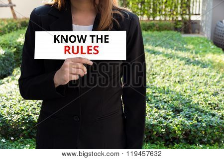 Know The Rules - Businesswoman Showing The Card